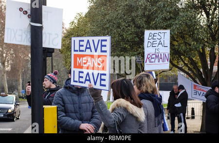 London, UK. 11th Jan, 2019. Pro Brexit and anti Brexit placards outside the Houses of Parliament in London today as the debate continues on Prime Minister Theresa May's deal which is to be voted on next week . Credit: Simon Dack/Alamy Live News - Stock Photo