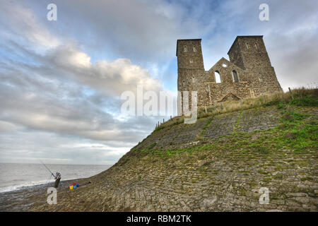 Reculver, Kent, UK. 11th Jan, 2019. Sightseers brave cold and damp weather at the imposing ruins of Reculver medieval church on the Thames Estuary, Herne Bay, Kent. Credit: Peter Cripps/Alamy Live News - Stock Photo