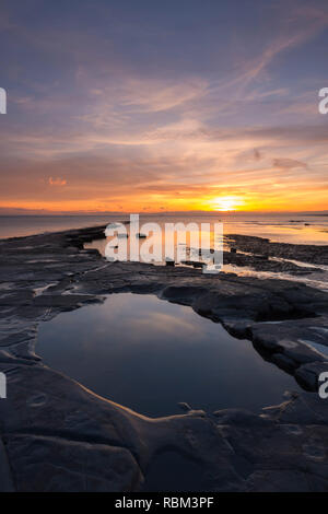 Kimmeridge, Dorset, UK. 11th Jan, 2019. UK Weather. A spectacular winter sunset viewed from the beach and ledges at Kimmeridge Bay on the Dorset Jurassic Coast. Picture Credit: Graham Hunt/Alamy Live News - Stock Photo