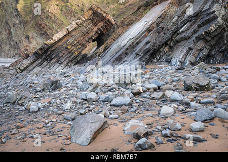 The spectacular landscape at Hartland Quay, famous for smugglers, shipwrecks and contorted layers of rock is also part of the popular South West Coast - Stock Photo