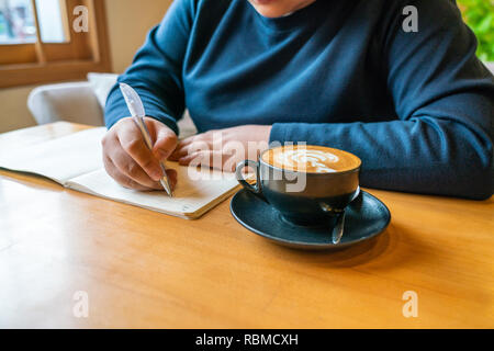 Young girl writing notes - Stock Photo