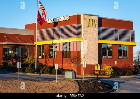 McDonald's restaurant at sunset on Atlanta Highway in Loganville, Georgia. (USA) - Stock Photo