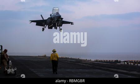 ARABIAN SEA – An F-35B Lightning II assigned to Marine Fighter Attack Squadron 211 (VMFA), 13th Marine Expeditionary Unit (MEU), prepares to land aboard the Wasp-class amphibious assault ship USS Essex (LHD 2), Jan. 9, 2019. The Essex is the flagship for the Essex Amphibious Ready Group and, with the embarked 13th MEU, is deployed to the U.S. 5th Fleet area of operations in support of naval operations to ensure maritime stability and security in the Central Region, connecting the Mediterranean and the Pacific through the western Indian Ocean and three strategic choke points. (U.S. Marine Corps - Stock Photo