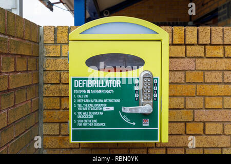 Wall mounted emergency defibrillator with instructions for public first aid use on the seafront in Southsea, Portsmouth, UK - Stock Photo