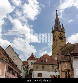 The stairs passage leads from lower town to upper town in Sibiu, Romania and gives a view of Santa Maria church - Stock Photo