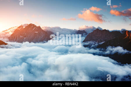 Creamy fog covered the famous glacier Marmolada in morning light. Picturesque and gorgeous scene. Location place Val di Fassa valley, passo Sella, Dol - Stock Photo