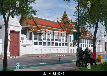 A side building of the Grand Palace in Bangkok, Thailand, seen from Sanam Chai Road - Stock Photo