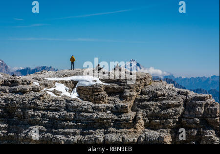 Tourists admire the landscape from Sass Pordoi (2950m). Pordoi is a pass in the Dolomites in the Alps, located between the Sella group in the north an - Stock Photo