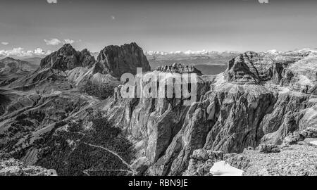 Marmolada mountain range seen from the Sass Pordoi plateau in Dolomites, Trentino Alto Adige, northern Italy, Europe - image in Black and White. - Stock Photo