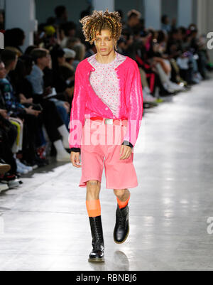 Fashion catwalk presentation at London Fashion Week Mens Autumn Winter 2019 presented by Bobby Abley models at British Fashion Council Show - Stock Photo