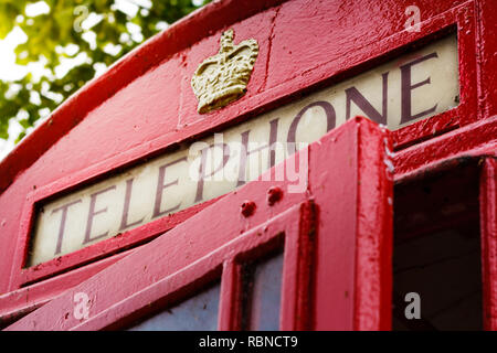 Traditional red british telephone box at summer in London - Stock Photo