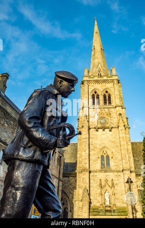 Memorial statue to the Durham Light Infantry by artist Alan Beattie in Durham Market Place with St Nicholas Church Tower - Stock Photo