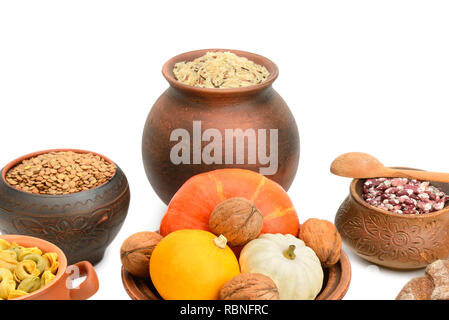 food in a ceramic pot isolated on white background - Stock Photo