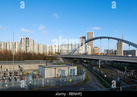 Apartments and bridge at East Village, Stratford, London UK, viewed from the Queen Elizabeth Olympic Park - Stock Photo