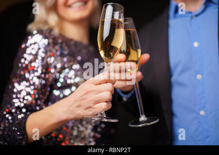 Photo of happy couple with champagne glasses in studio - Stock Photo