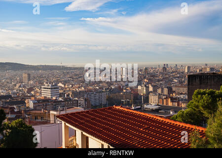 Morning panorama of Barcelona taken from Park Güell - rooftops, historical buildings, beautiful sunny weather - Stock Photo