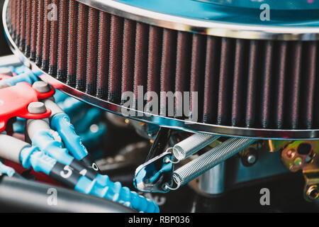 Shiny air cleaner and engine components under hood of vintage hot-rod with vintage toning. - Stock Photo