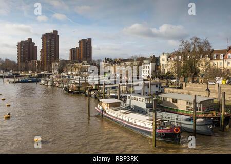 Houseboats moored at Chelsea Wharf London - Stock Photo