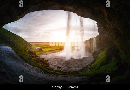 Perfect view of famous powerful Seljalandsfoss waterfall in sunlight. Dramatic and gorgeous scene. Popular tourist attraction. Location place Iceland, - Stock Photo