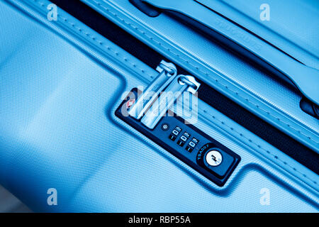 PARIS, FRANCE - JAN 22, 2018: Closeup detail of a Samsonite suitcase briefcase with focus on the logo and TSA combination lock password number in blue business tone  - Stock Photo