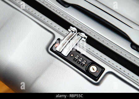 PARIS, FRANCE - JAN 22, 2018: Closeup detail of a Samsonite suitcase briefcase with focus on the logo and TSA combination lock password number  - Stock Photo