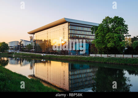 STRASBOURG, FRANCE - APR 21, 2017: Agora Council of Europe building in Strasbourg construction at sunset with sun reflected in window  - Stock Photo