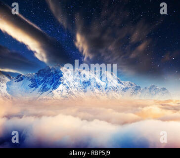 The Milky Way over the winter mountains landscape. Creative collage. Upper Svaneti, Georgia, Europe. Caucasus mountains. Beauty world. - Stock Photo