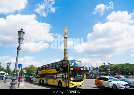 Berlin, Germany - May 31, 2017: city circle sightseeing bus in street road with berlin victory column on background in germany. city bus for travelers in berlin. touristic route for destination place - Stock Photo