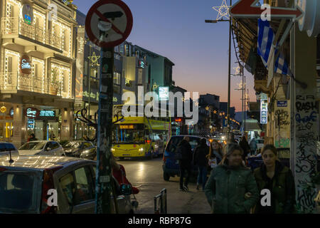 It was always busy in downtown Athens during my stay. The streets buzzed with tourists and locals enjoying the spirit of Christmas time. - Stock Photo