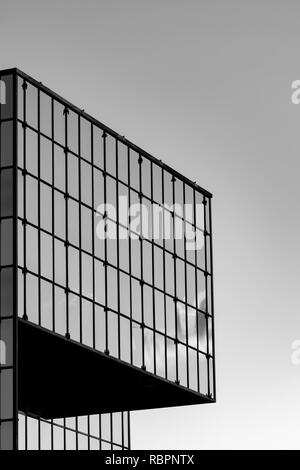 Modern building with curtain wall glass facade, black and white - Stock Photo