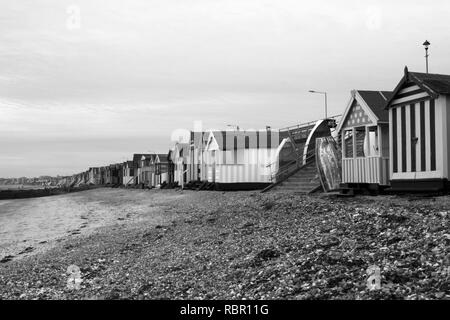 Black and white image of the beach huts at - Stock Photo
