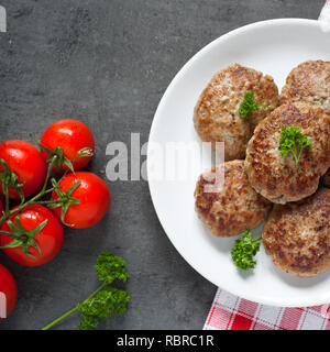 Fresh fried cutlets in a white plate. - Stock Photo