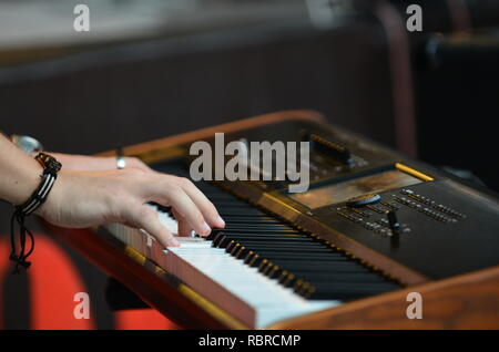 playing on piano - Stock Photo