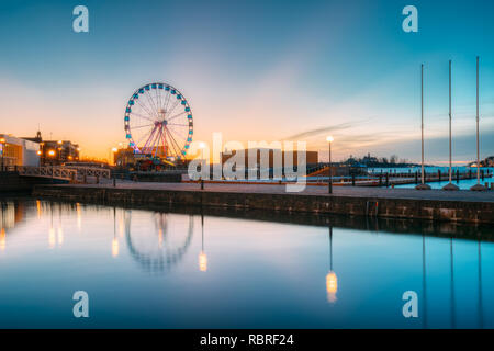 Helsinki, Finland. View Of Embankment With Ferris Wheel In Sunrise Morning. - Stock Photo