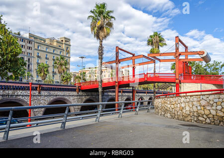 Barcelona, Spain - November 10, 2018: Passeig de Colom with a red bridge over the road - Stock Photo