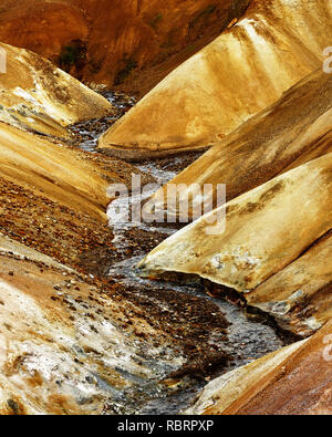 Strongly structured landscape in ocher and brown tones with a small river - Location: Iceland, Highlands, area 'Kerlingarfjöll' - Stock Photo