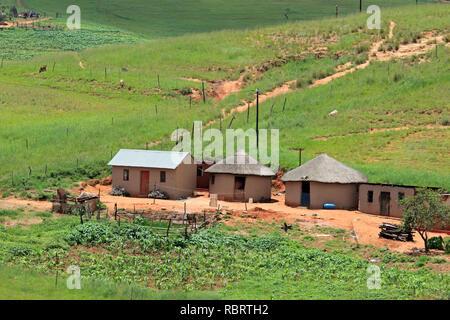 Small rural settlement in mountainous grassland, KwaZulu-Natal, South Africa - Stock Photo