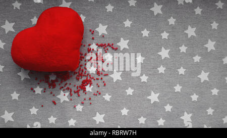 Valentines day background with soft toy heart on a gray background with white stars. Top view. for banner, cards design - Stock Photo