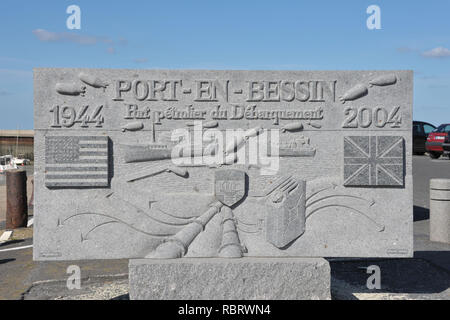 Commemorative stone illustrating the World War Two operations in Port-en-Bessin-Huppain, Normandy, France - Stock Photo