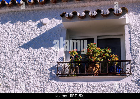 Window. Traditionally decorated Spanish windows with flower pots. - Stock Photo