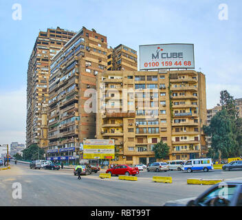 GIZA, EGYPT - DECEMBER 19, 2017: The dense residential quarters at the Cairo University Bridge, connecting Giza with Gezira Island and Cairo, on Decem - Stock Photo