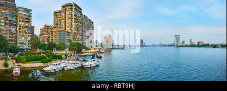 GIZA, EGYPT - DECEMBER 19, 2017: Panorama with old residential high-rises along the Nile river's bank of Giza, buildings of Rhoda Island and Gezira Is - Stock Photo