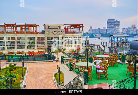 GIZA, EGYPT - DECEMBER 19, 2017: The luxury ship restaurant on the Nile river with large outdoor terrace and Rhoda Island on the background, on Decemb - Stock Photo