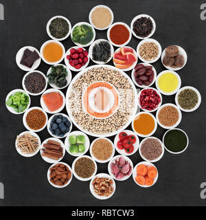 Large health food wheel with foods to slow the ageing process down. Very high in antioxidants, anthocyanins, dietary fibre and vitamins. - Stock Photo