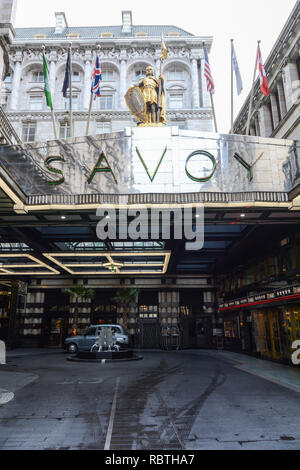 Frontage and entrance to the luxury Savoy Hotel on the Strand, London, UK - Stock Photo