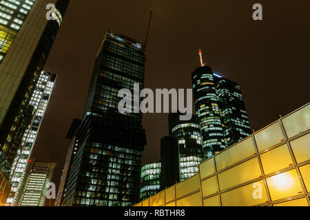 Frankfurt am Main, Germany - January 08, 2019: skyscrapers in the financial district of Frankfurt at night, with unidentified people. Frankfurt is the - Stock Photo
