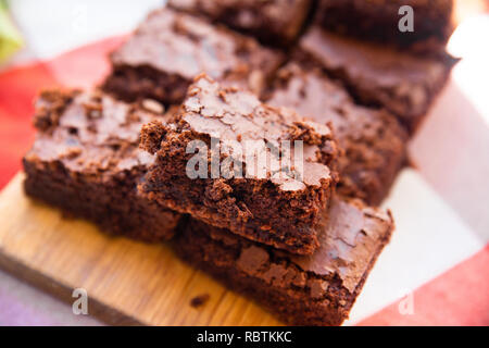 Home baked Pieces of rich fudge brownies - Stock Photo