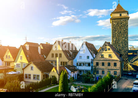 Rothenburg ob der Tauber, Germany. Top view of picturesque town on bright blue sky copy space background. Nice cottages with steep roofs, high stone t - Stock Photo