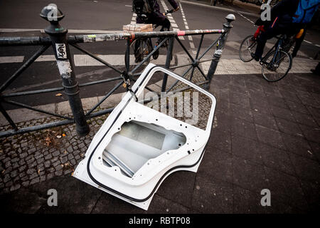 Berlin, Germany. 18th Dec, 2018. A car door is locked to a railing at the Kottbusser Tor. Credit: Christoph Soeder/dpa/Alamy Live News - Stock Photo