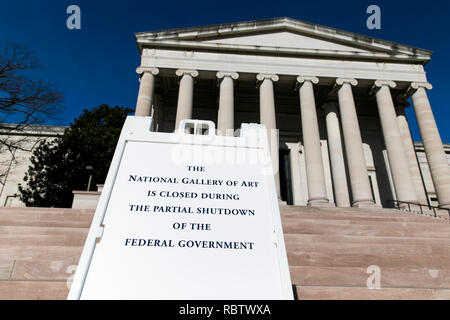 Washington, DC, USA. 11th Jan, 2019. A sign outside of the National Gallery Of Art informing visitors that the museum is closed due to the partial Government shutdown in Washington, DC on January 11, 2019. The shutdown, now entering it's 22nd day, is the longest Government shutdown in U.S. history. Credit: Kristoffer Tripplaar/Alamy Live News - Stock Photo